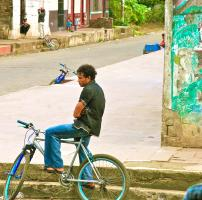 Boy on Blue Bicycle, León. Photograph by Dan Mangan