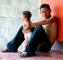 Young Father and Child. Photograph by Dan Mangan
