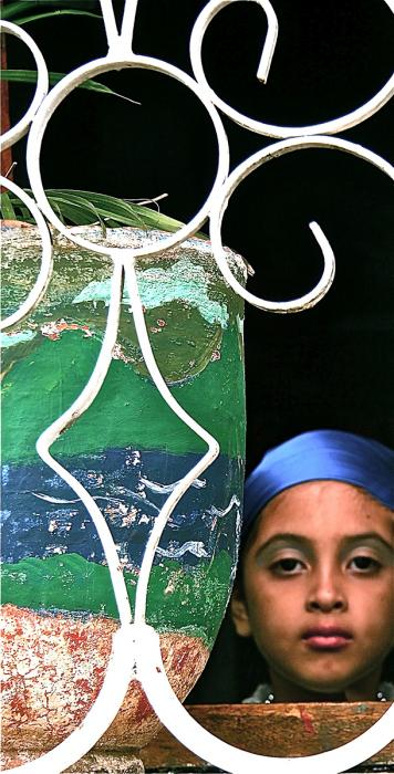 Girl In Wrought Iron Window, León. Photograph by Dan Mangan