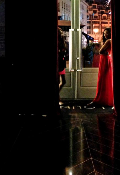 Woman in Red Chiffon, Boulevard des Capucines. Photograph by Dan Mangan